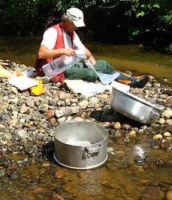 David Strain preparing sample bags for the collection of heavy mineral stream sediment samples in the Eskay Creek area, British Columbia