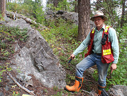 Prospector Cameron Barker exploring for porphyry copper mineralization associated with alkaline intrusive rocks in the Quesnel Trough of British Columbia